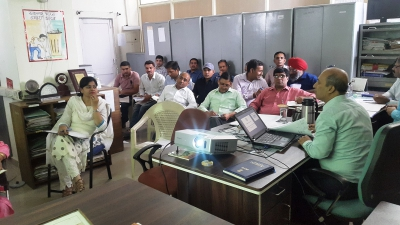 Deputy Director (National trainer ) of DCO Haryana educating office staff about the procedure to fill schedules of Census 2021 Pre-Test